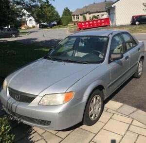 Mazda Protégé 2001 - BAS KILO!! - A/C - PERLE RARE - nego