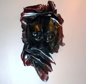 MOVING ------ Leather Form of Man and Woman - For Sale