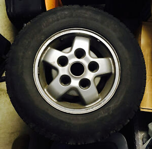 4-Land Rover rims with Michelin M/S tires.
