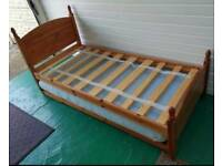 Solid pine single bed with pull out under bed