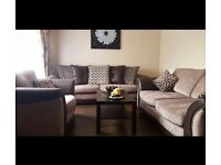 3 piece sofa. New condition. Really comfy and beautiful brown and warm tan colour. Reversible pillow