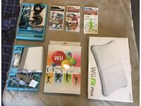 Wii console, fit plus, wii accessory pack, hand controls, 5 games
