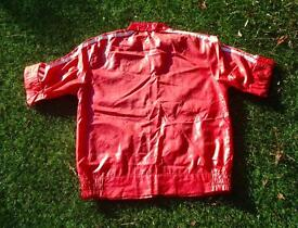 SHINY 1970s RED NYLON JACKET WITH RACING STRIPES.