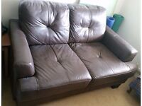 Two seat leather settee