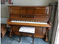 Stradmar upright piano.