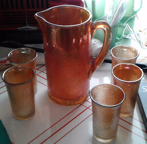 Carnival glass water pitcher and five matching tumblers