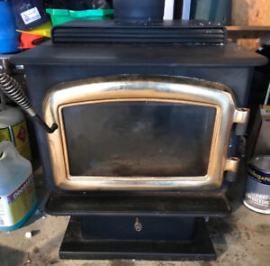 Regency Wood stove with 10 feet of pipe and accessories