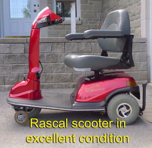 SCOOTER WITH POWER ELEVATING SEAT
