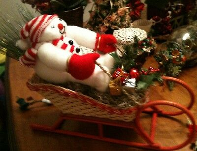 Handcrafted Christmas Snowman In Floral Decorated Wicker Sleigh