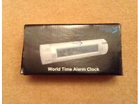 Travel world time alarm clock. Brand new, unsed and boxed. Unwanted gift.