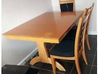 Extendible dining table and 6 chairs