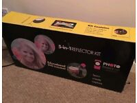 reflector with stand, new in box