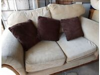 FABRIC CREAM TWO SEATER SOFA WITH WOOD SURROUND USED CONDITION FREE LOCAL DELIVERY AVAILABLE
