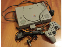 PS1 WITH BOX BOOKLET AND AN ARRAY OF GAMES + AN EXTRA CONTROLLER