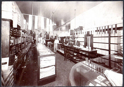 vintage photo clothes store interior hats ties belts display cases family photos - Family Clothes Store