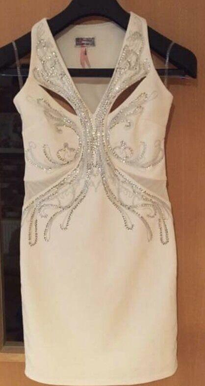 LIPSY Dress. Brand newin Scarborough, North YorkshireGumtree - Size 10 beautiful white LIPSY dress. Never worn.White. LIPSY. Bodycon. Immaculate. Beading. Mesh inserts. Beautiful fit