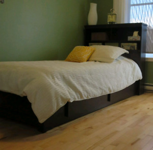 Single bed platform with mattress and linen