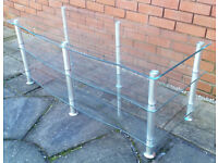 large media bench table, glass shelves with chrome legs. 130cm x 52cm. In very good condition