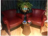 Pair of vintage ox blood armchairs