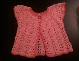 Handmade crochet dress for a baby girl