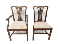 A set of six reproduction Chippendale style mahogany dining chairs