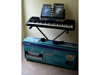 Yamaha beginner's keyboard, boxed, with stand