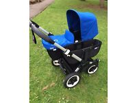 Bugaboo donkey with royal blue sun canopies.