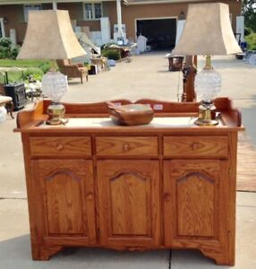 Buffet cabinet within layed raw marble slabs