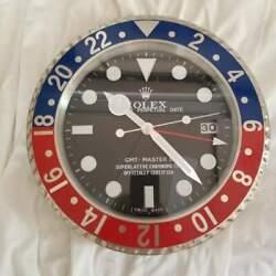 GMT dealer wall clock, red & blue