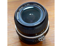 Nikon Nikkor 28mm f/3.5 AI Lens, boxed, near mint. Price includes postage.