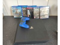 PlayStation 4 PRO 1TB console with 5 Top Games and pad
