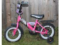 12-inch girl's bike with stabilisers