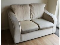 2 Seater Fabric Sofa in Cream Comfortable, Used Condition