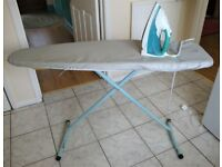 Electric steam iron and ironing board