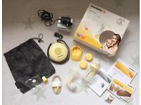 Medela Swing Electric Breastpump / breast pump with Calma