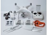 DJI Phantom 4 with 2 batteries, filters and spare set of propellers