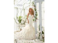 Wedding Dresses for great prices - SAMPLE and BRAND NEW dresses, based in Surrey