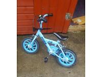 Small blue kids bike read add