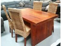 Solid jalhi wood dining table and 4 high back chairs can deliver 07808222995