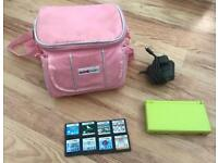 Nintendo DS Lite with charger, case and a range of games