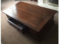 Solid dark wood coffee table with storage