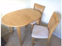 Solid wood extendable Dining Table with 4 padded chairs. Excellent condition. £100 (collection only)