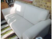 Three seated cream sofa