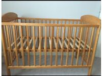 Mamas and Papas drop side cot in pine.