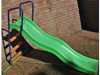 Garden outdoor slide Blue and green tubular metal frame, plastic green slide.