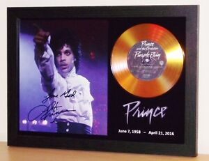 PRINCE SIGNED PHOTO AND 'PURPLE RAIN' GOLD CD DISC COLLECTABLE MEMORABILIA