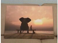 Elephant and Dog Sit on a Summer Beach at Sunset by Mike Kiev - Graphic Art Print on Canvas