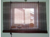 Five natural bamboo and reed roller blinds