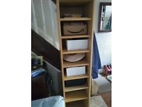 Tall revolving storage unit with shelves and full length mirror light oak