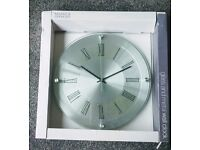 Wall clock. Glass and Metal by Mark's and Spencers. As New in box.